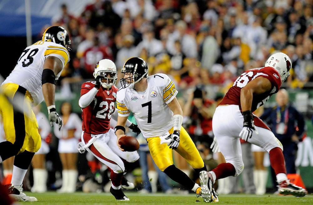 TAMPA, FL - FEBRUARY 01: Quarterback Ben Roethlisberger #7 of the Pittsburgh Steelers tries to escape the rush by the defense of the Arizona Cardinals during Super Bowl XLIII on February 1, 2009 at Raymond James Stadium in Tampa, Florida. The Steelers defeated the Cardinals 27 to 23. (Photo by Rob Tringali) *** Local Caption *** Ben Roethlisberger