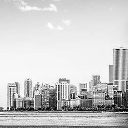 North Chicago skyline panorama black and white photo. Panorama photo ratio is 1:3 and includes Chicago lakefront downtown city buidlings on the Near North Side with the John Hancock Center Building which is a famous part of the Chicago skyline and is one of the tallest skyscrapers in the world. Copyright © 2012 Paul Velgos with All Rights Reserved.