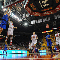 16 February 2013:   Duke Blue Devils forward Mason Plumlee (5) scores on a dunk in action against Maryland Terrapins guard Seth Allen (4) at the Comcast Center in College Park, MD. where the Terrapins defeated the Blue Devils, 83-81.