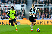 Florian Lejeune (#20) of Newcastle United dribbles the ball up the pitch during the Premier League match between Newcastle United and Huddersfield Town at St. James's Park, Newcastle, England on 23 February 2019.