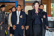 """09 JANUARY 2105 - BANGKOK, THAILAND: YINGLUCK SHINAWATRA, former Prime Minister of Thailand, walks into Parliament House in Bangkok for her impeachment trial. Thailand's military-appointed National Legislative Assembly began impeachment hearings Friday against former Prime Minister Yingluck Shinawatra. If she is convicted, she could be forced to stay out of politics for five years. During her defense, Yingluck questioned the necessity of her impeachment, saying, """"I was removed from office, the equivalent of being impeached, three times already, I have no position left to be impeached from."""" A decision on her impeachment is expected by the end of January.    PHOTO BY JACK KURTZ"""