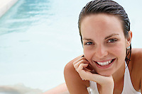 Young woman relaxing in swimming pool portrait close-up