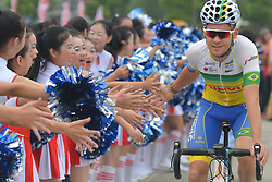 September 20, 2017 - Changde, China - A member of Soul Brasil Pro Cycling Team welcomed by local teens ahead of the start to the second stage of the 2017 Tour of China 2, the 97.6km Changde Lixiang Circuit Race. .On Wednesday, 20 September 2017, in Lixian County, Changde City, Hunan Province, China. (Credit Image: © Artur Widak/NurPhoto via ZUMA Press)