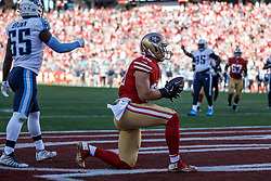 SANTA CLARA, CA - DECEMBER 17: Tight end Garrett Celek #88 of the San Francisco 49ers scores a touchdown against the Tennessee Titans during the second quarter at Levi's Stadium on December 17, 2017 in Santa Clara, California.  (Photo by Jason O. Watson/Getty Images) *** Local Caption *** Garrett Celek