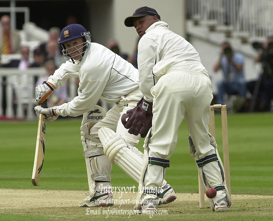 .Sport - Cricket - 22/06/02.Photo Peter Spurrier.Benson & Hedges - Final Lords Essex vs Warwickshire.Paul Grayson (batting) and wicket keeper Keith Piper watch  Grayson's gentle touch. [Mandatory Credit: Peter Spurrier:Intersport Images]