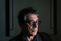 "ROME, ITALY - 21 FEBRUARY 2020:  Italian novelist and essayist Sandro Veronesi (60) poses for a portrait in his home in Rome, Italy, on February 21st 2020.<br /> <br /> In 2006 Sandro Veronesi won the Strega Prize, the most prestigious Italian literary award, with his book ""Caos Calmo"". His latest novel is ""Il Colibrì"" (2019)."