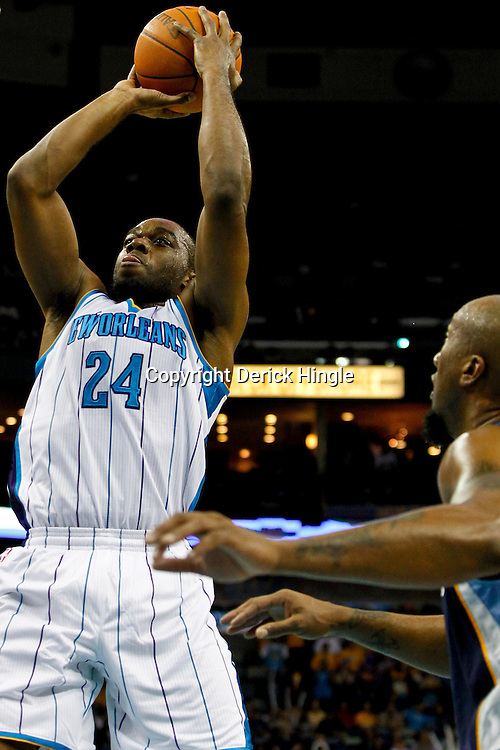 December 21, 2011; New Orleans, LA, USA; New Orleans Hornets power forward Carl Landry (24) shoots over Memphis Grizzlies forwardcenter Brian Skinner (3) during the first quarter of a preseason game at the New Orleans Arena.  The Hornets defeated the Grizzlies 95-80. Mandatory Credit: Derick E. Hingle-US PRESSWIRE