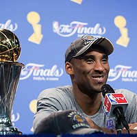 14 June 2009: Kobe Bryant of the Los Angeles Lakers is seen next to the MVP trophy during the press conference after game 5 of the 2009 NBA Finals won 99-86 by the Los Angeles Lakers over the Orlando Magic at Amway Arena, in Orlando, Florida, USA. Kobe Bryant scores 30 points and leads the Lakers to15th Championship.