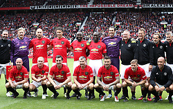 Players line up during the legends match at Old Trafford, Manchester.