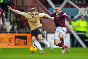 Lewis Ferguson (#19) of Aberdeen FC turns inside Michael Smith (#2) of Heart of Midlothian FC during the Ladbrokes Scottish Premiership match between Heart of Midlothian FC and Aberdeen FC at Tynecastle Stadium, Edinburgh, Scotland on 29 December 2019.
