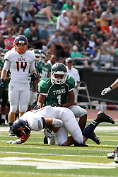 28 September 2013:  Ben Bouie gets a Flying Dutchmen during an NCAA division 3 football game between the Hope College Flying Dutchmen and the Illinois Wesleyan Titans in Tucci Stadium on Wilder Field, Bloomington IL