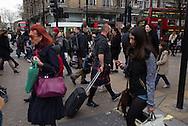 A man wearing a Scottish kilt in Oxford street, London.