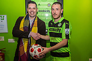 Forest Green Rovers Liam Noble(15) with match ball sponsor ESS Employment during the Vanarama National League match between Forest Green Rovers and Wrexham FC at the New Lawn, Forest Green, United Kingdom on 18 March 2017. Photo by Shane Healey.