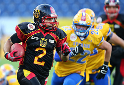 03.06.2014, NV Arena, St. Poelten, AUT, American Football Europameisterschaft 2014, Gruppe A, Schweden (SWE) vs Deutschland (GER), im Bild Danny Washington, (Team Germany, RB, #2) und Pontus Westman, (Team Sweden, LB, #22) // during the American Football European Championship 2014 group A game between Sweden vs Germany at the NV Arena, St. Poelten, Austria on 2014/06/03. EXPA Pictures © 2014, PhotoCredit: EXPA/ Thomas Haumer