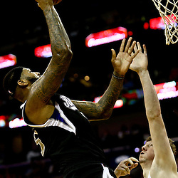Mar 7, 2016; New Orleans, LA, USA; Sacramento Kings center DeMarcus Cousins (15) shoots over New Orleans Pelicans center Omer Asik (3) during the second quarter of a game at the Smoothie King Center. Mandatory Credit: Derick E. Hingle-USA TODAY Sports