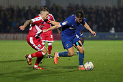 AFC Wimbledon midfielder Callum Reilly (33) dribbling during the EFL Sky Bet League 1 match between AFC Wimbledon and Gillingham at the Cherry Red Records Stadium, Kingston, England on 23 November 2019.