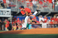 Mississippi's Chris Ellis (10) pitches in an NCAA Super Regional game in Lafayette, La. on Saturday, June 7, 2014.    Louisiana-Lafayette won 9-5.