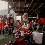 Catcher, Lexi Overstreet, gets geared up before the game.<br /> <br /> Todd Spoth for The New York Times.