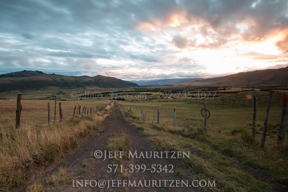 Sunrise over fenced in agricultural land on the side of Ruminahui volcano in Ecuador.