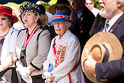 "President General of the United Daughters of the Confederacy June Murray Wells and Director of the Confederate Museum sings ""Dixie"" during Confederate Memorial Day at Magnolia Cemetery April 10, 2014 in Charleston, SC. Wells traces here heritage back 345 years to the first settlers in Charleston."