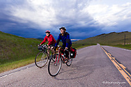 Bicycle touring on a stormy afternoon on Highway 435 near Wolf Creek, Montana, USA model released