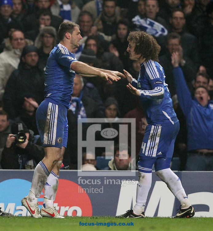 Picture by Paul Terry/Focus Images Ltd. 07545642257.14/03/12. Branislav Ivanovic (L) and David Luiz of Chelsea celebrate after Ivanovic scored to make it 4-1 during the UEFA Champions League last 16 second leg match at Stamford Bridge stadium, London.