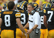 September 3, 2011: Iowa Hawkeyes head coach Kirk Ferentz greets players after an extra point following a touchdown during the first half of the game between the Tennessee Tech Golden Eagles and the Iowa Hawkeyes at Kinnick Stadium in Iowa City, Iowa on Saturday, September 3, 2011. Iowa defeated Tennessee Tech 34-7 in a game stopped at one point due to lightning and rain.