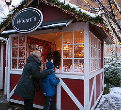 Small wooden craft shop at Christmas market inside Liseberg amusement park in Gothenburg Sweden
