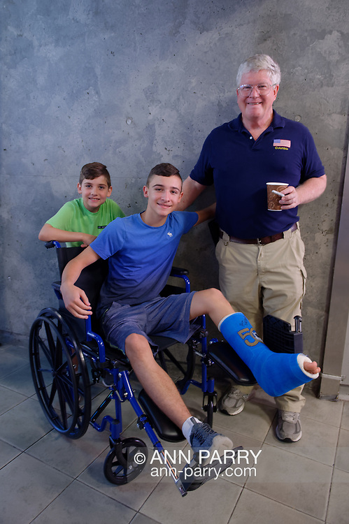 Garden City, New York, U.S. July 20, 2019. At right, NASA Space Shuttle astronaut  BILL SHEPHERD poses with (in wheelchair) JOSEPH (JOEY) CASABIANCA, 13, and brother MICHAEL CASABIANCA, 8, both of Wantagh, after  Shepherd autographed Joey's foot cast decorated with Apollo 50 design, at the Moon Fest Apollo at 50 Countdown Celebration at Cradle of Aviation Museum in Long Island, during the time Apollo 11 Lunar Module landed on the Moon 50 years ago.