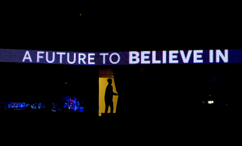 "A supporter peeks through the curtain during U.S. Democratic Presidential candidate Senator Bernie Sanders' (I-Vt.) ""Future to Believe In"" Rally at the Kohl Center in Madison, Wisconsin April 3, 2016."