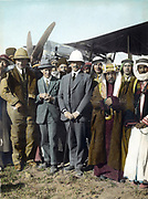 On the airfield at Amman,  Jordan, April 1921:  T E Lawrence,  Sir Herbert Samuel (British High Commissioner of Palestine), Emir Abdullah. Woman far left, possibly Gertrude Bell. Sheik Majid Pasha el Adwan, far right.