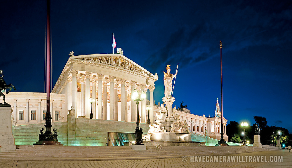 Panoramic shot of Austria's Parliament House at night.