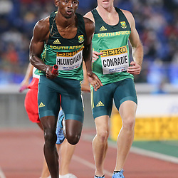 YOKOHAMA, JAPAN - MAY 11: Ashley Hlungwani receives the baton from Pieter Conradie in the mens 4x400m relay during day 1 of the IAAF World Relays at Nissan Stadium on May 11, 2019 in Yokohama, Japan. (Photo by Roger Sedres/Gallo Images)