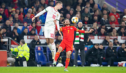CARDIFF, WALES - Tuesday, November 19, 2019: Wales' Joe Allen challenges for a header with Hungary's Dominik Szoboszlai during the final UEFA Euro 2020 Qualifying Group E match between Wales and Hungary at the Cardiff City Stadium. (Pic by Laura Malkin/Propaganda)