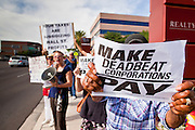 18 APRIL 2011 - PHOENIX, AZ: About 50 members of MoveOn.org gathered at the office of US Sen. John McCain (R-AZ) in Phoenix, AZ, Monday, Apr. 18, to draw attention to corporations that don't pay U.S. taxes. A representative of the group went into McCain's office present the Senator's staff with a tax bill for the 12 corporations they say paid no US income taxes.      Photo by Jack Kurtz
