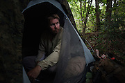 "DACULA, GA – JUNE 6, 2014: Karl Bushby rests in a tent after walking several miles on Highway 124 in Georgia. ""If I'm not walking, I'm either waiting to get walking or planning for the next part of the journey.""<br /> <br /> Karl Bushby is trying to complete the longest walk in history. Unless the Russians stop him. As a 45 year-old Brit, Bushby been traveling around the world on foot since 1998. In the most recent leg of his journey, Bushby is walking to Washington, D.C. to petition the Russian Embassy to lift a visa ban that prohibited him from continuing his hike through Russia."