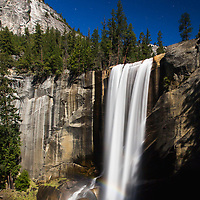 One of many beautiful waterfalls in Yosemite, Vernal Falls happens to be in a good spot to receive the direct light from a full moon.  Even captured a moonbow in this long exposure. © John McBrayer 2015