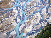 The Stunning Beauty of Braided Rivers<br /> <br /> Most rivers flow in one broad channel of water, but some rivers split into lots of small channels that continually split and join each other to give a braided appearance. These are called braided rivers.<br /> <br /> Braided rivers are usually wide but shallow. They typically form on fairly steep slopes and carry large amount of coarse-grained sediments. When the river's flow decreases, these sediments get deposited on the river bed leaving behind small temporary islands of sands that cause the river's channel to split. Aside from a steep gradient and abundance of sediments, a variable water discharge rate is essential to their formation. Consequently, braided rivers exist near mountainous regions, especially those with glaciers. Braided channels are also found in environments that dramatically decrease channel depth, and hence channel velocity, such as river deltas, alluvial fans and peneplains.          <br /> <br /> Photo shows: The Waimakariri River<br /> ©Exclusivepix Media