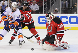Mar 8; Newark, NJ, USA; New Jersey Devils goalie Martin Brodeur (30) makes a save while New Jersey Devils defenseman Bryce Salvador (24) and New York Islanders left wing Matt Moulson (26) fight for the rebound during the first period at the Prudential Center.