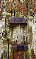 Close-up detail of weathered wooden fence post