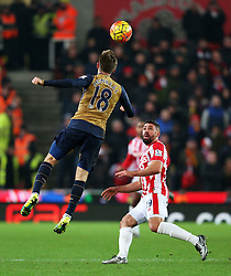 Arsenal's Nacho Monreal wins a header above Jonathan Walters of Stoke City  - Mandatory byline: Matt McNulty/JMP - 17/01/2016 - FOOTBALL - Britannia Stadium - Stoke, England - Stoke City v Arsenal - Barclays Premier League