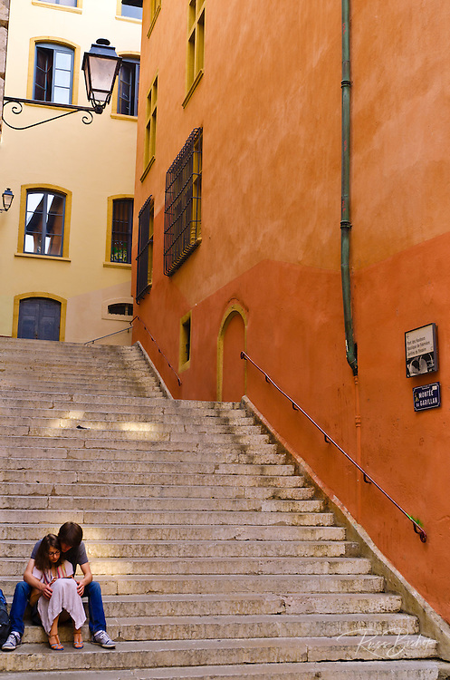Couple on stairs in old town Vieux Lyon, France (UNESCO World Heritage Site)