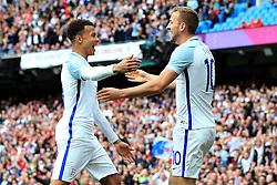 England's Harry Kane celebrates with Dele Alli after the first goal - Mandatory byline: Matt McNulty/JMP - 07966386802 - 22/05/2016 - FOOTBALL - Etihad Stadium -Manchester,England - England v Turkey - International Friendly