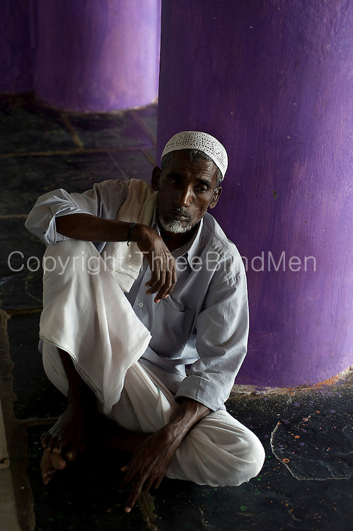 Man seated at Dargah shrine. Nagore.
