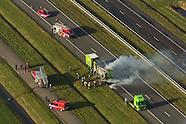 Luchtfoto's van brand vrachtauto McDonald's Recycling op autosnelweg A31 bij Leeuwarden