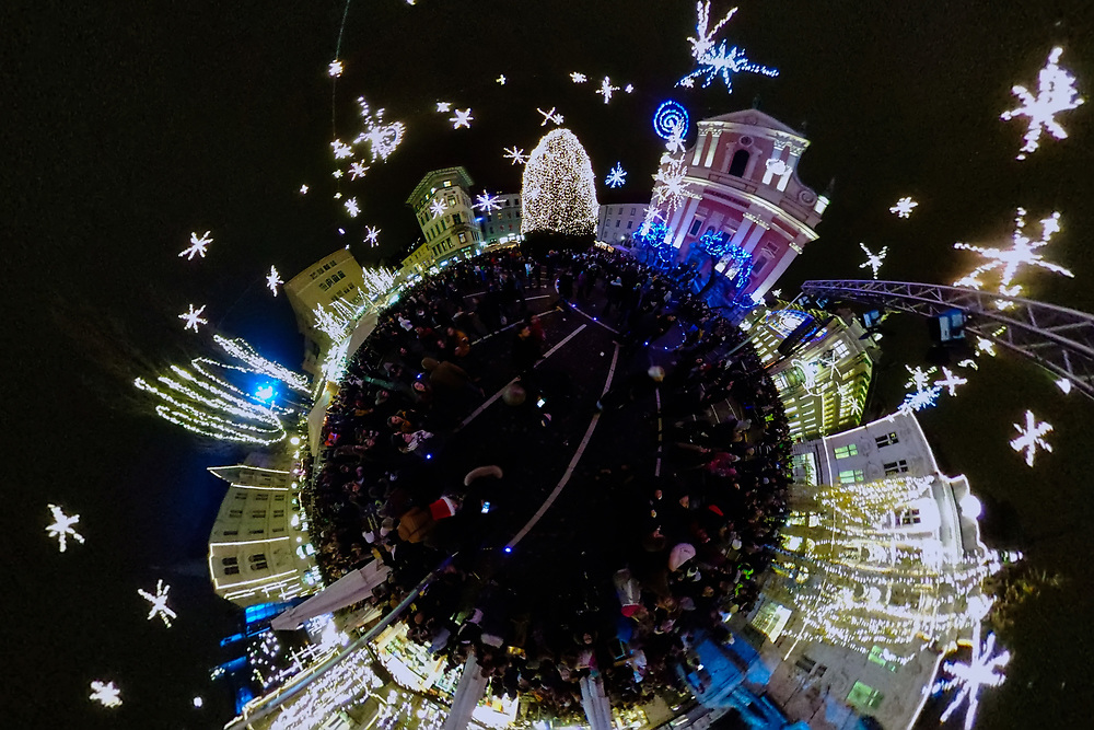 LJUBLJANA, SLOVENIA - DECEMBER 02: (EDITOR'S NOTE: This image has been digitally altered in post) A little planet of Christmas light and decorations in Preseren Trg. on December 2, 2017 in Ljubljana, Slovenia. The traditional Christmas market and lights will stay until 1st week of January 2018.  (Photo by Marco Secchi/Getty Images)