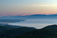 View from Mt. Erie (on Fidalgo Island, Washington State, USA) of the Straight of Juan de Fuca, Naval Air Station Whidbey Island (ault field), and the Olympic Mountains.  Photographed from Mount Erie Park in Anacortes, Washington.