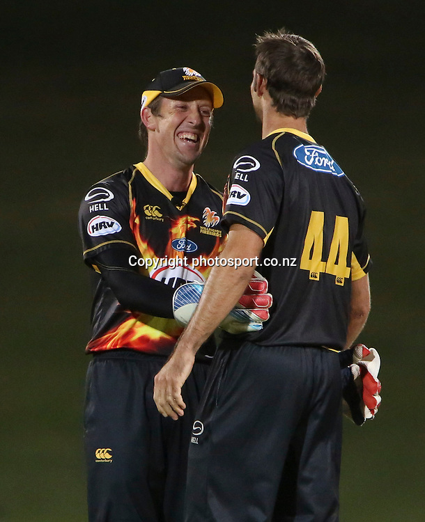 Wellington's Luke Ronchi congratulates Grant Elliott taking a wicket  in the HRV Cup T20 cricket match between the Central Districts Stags and the Wellington Firebirds at McLean Park, Napier, New Zealand. Friday, 07 December, 2012. Photo: John Cowpland / photosport.co.nz