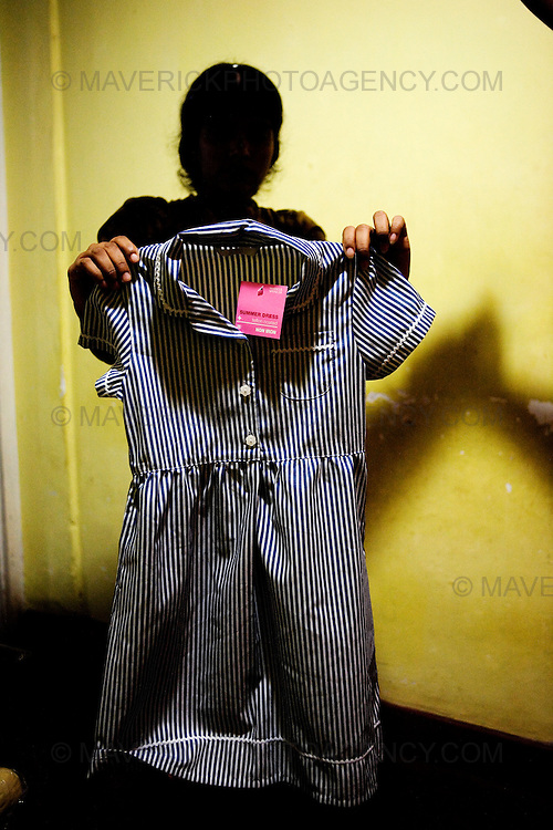 General views of a clothing factory in Colombo, Sri Lanka which manufactures goods for export to western markets. Picture shows a garment worker holding a Marks and Spenser School Uniform which is manufactured at the factory...