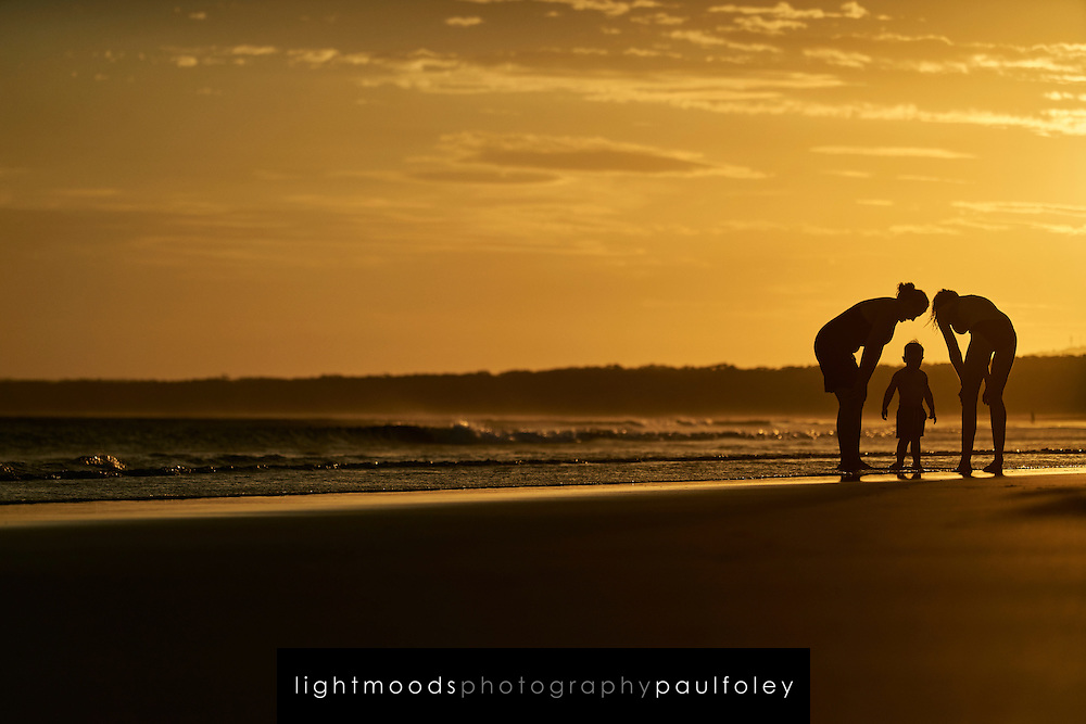 Family enjoying sunset at 7 Mile Beach, Gerroa, NSW, South Coast, Australia